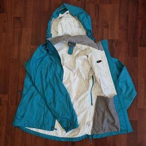REI NWOT teal rain shell jacket